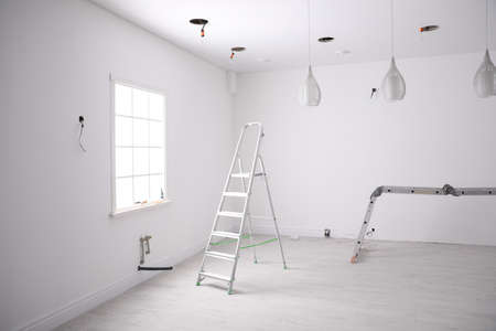 Empty room with stretch ceiling and ladders Standard-Bild