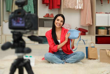 Fashion blogger recording new video in room Banco de Imagens - 138281935