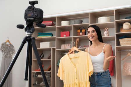 Fashion blogger recording new video in room Banco de Imagens - 138281970