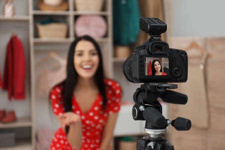 Fashion blogger recording new video in room, focus on camera Banco de Imagens - 138282152