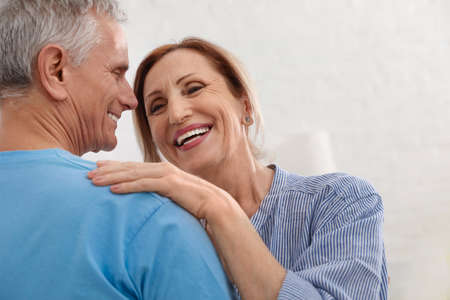 Happy senior couple dancing together at home, closeup