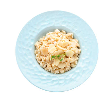 Delicious risotto with cheese isolated on white, top view Banco de Imagens
