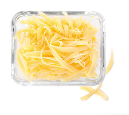 Glass bowl with grated cheese isolated on white, top view
