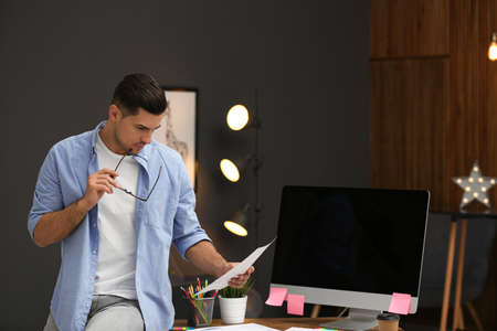 Male designer working in office. Creative profession Stock Photo