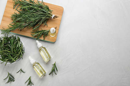 Flat lay composition with fresh rosemary on light table. Space for text Banco de Imagens