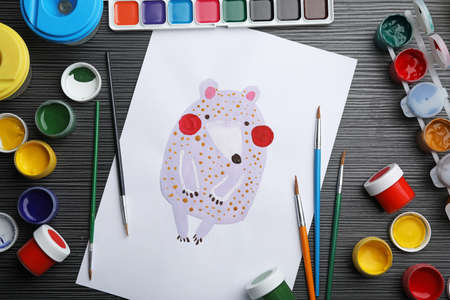 Flat lay composition with childs painting of bear on grey wooden table