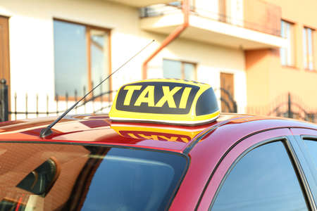 Roof light with word TAXI on car outdoors 写真素材