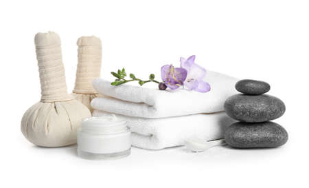 Beautiful spa composition with herbal bags on white background