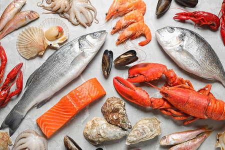 Fresh fish and seafood on marble table, flat lay 版權商用圖片