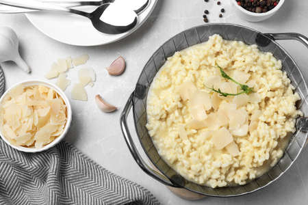Delicious risotto with cheese on grey marble table, flat lay Imagens