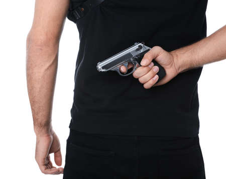 Professional killer with gun on white background, closeup