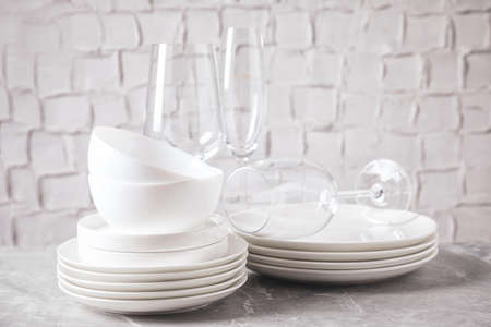 Set of clean dishware on marble table