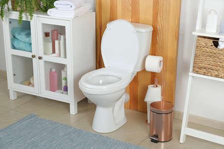 Stylish toilet bowl in modern bathroom interior
