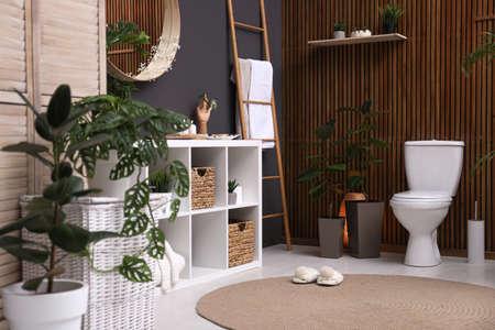 Elegant interior of modern bathroom with green plants 写真素材