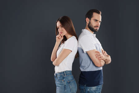 Couple with relationship problems on black background