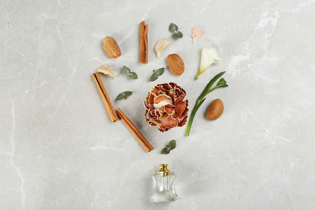 Flat lay composition with bottle of perfume on marble background