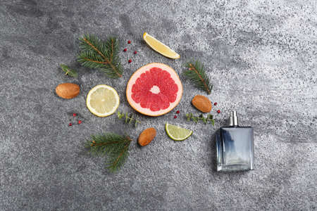 Flat lay composition with bottle of perfume on grey background Stock Photo
