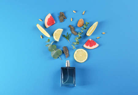 Flat lay composition with bottle of perfume on blue background Stock Photo
