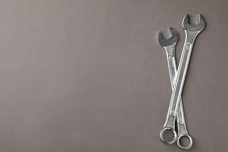 Auto mechanics tools on grey background, flat lay. Space for text