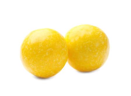 Tasty small lemon drops isolated on white Reklamní fotografie