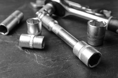 Auto mechanics tools on grey background, closeup Stockfoto