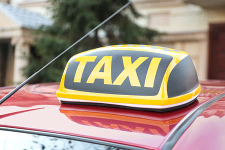 Roof light with word TAXI on car outdoors Reklamní fotografie