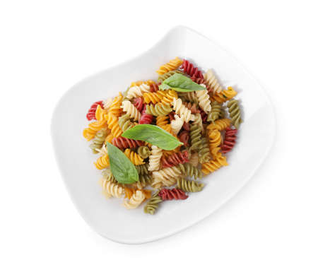 Delicious vegetable spiraline pasta with basil isolated on white