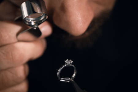 Professional jeweler working with ring, closeup view