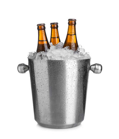 Beer in metal bucket with ice isolated on white Stock Photo