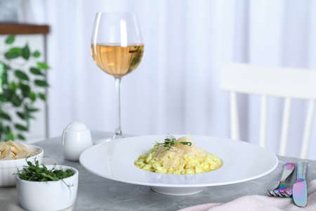 Delicious risotto with cheese on grey marble table indoors Imagens