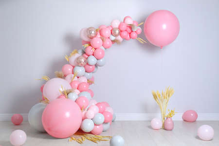 Beautiful composition with balloons and spikelets near light wall