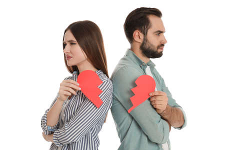 Couple with torn paper heart on white background. Relationship problems