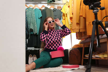 Fashion blogger recording new video in dressing room
