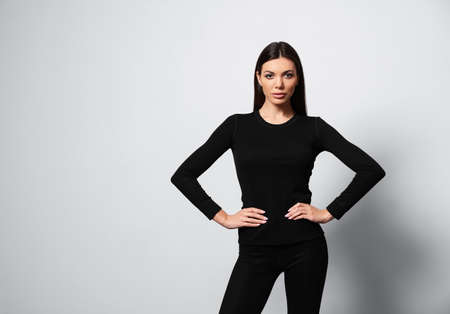 Woman wearing thermal underwear on light grey background. Space for text