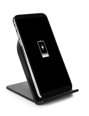 Mobile phone charging with wireless pad isolated on white