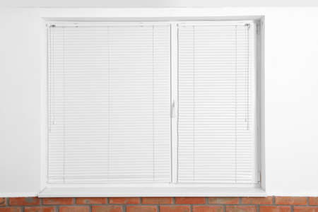 Modern window with closed blinds in room Stock fotó