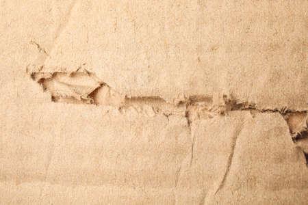 Torn sheet of cardboard as background, closeup Stockfoto