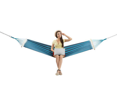 Woman with laptop in hammock on white background