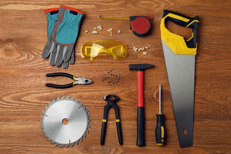 Different carpenter's tools on wooden background, flat lay