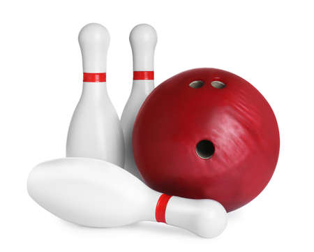 Red bowling ball and pins isolated on white Stock Photo