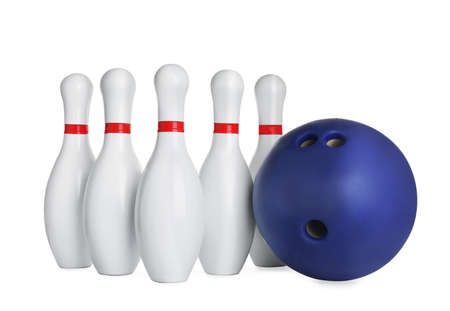 Blue bowling ball and pins isolated on white Stock Photo