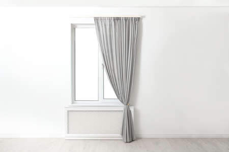 Modern window with beautiful curtains in room Stock fotó