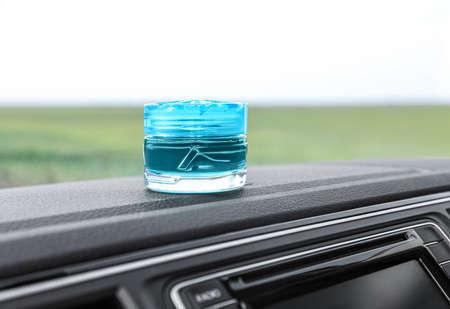 Stylish air perfume on dashboard in car