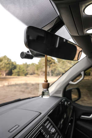 air perfume hanging on rear view mirror in car