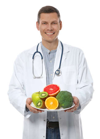 Nutritionist with healthy products on white background