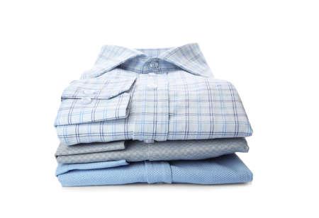 Stack of stylish male shirts isolated on white Stock Photo