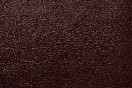 Textura de cuero marrón oscuro como fondo, primer plano Foto de archivo