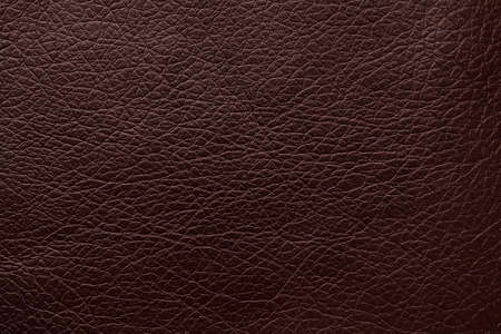Texture of dark brown leather as background, closeup