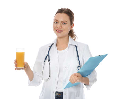 Nutritionist with glass of juice and clipboard on white background