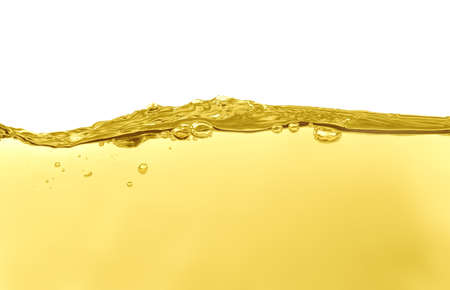Flow of natural cooking oil on white background